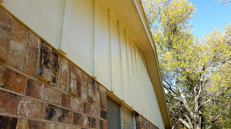 Siding painting in Euless, Texas