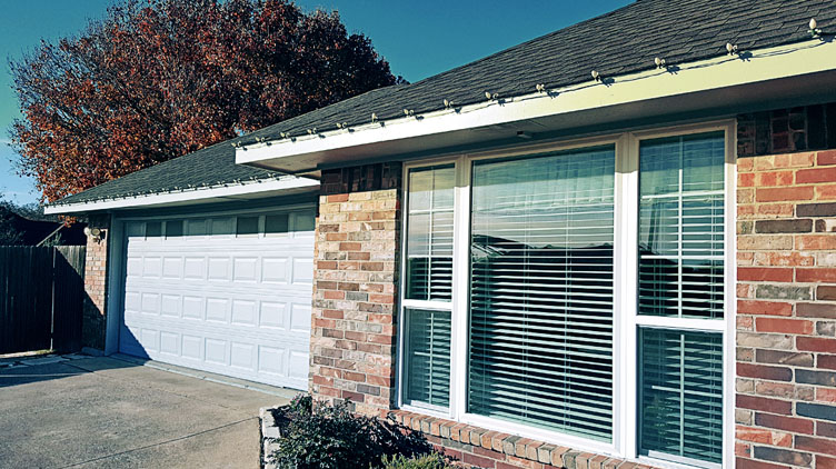 Garage door and trim painting in Keller, Texas