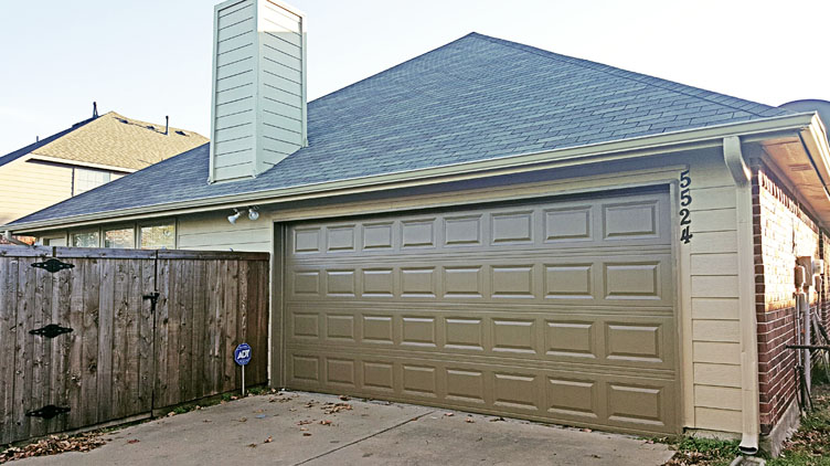 Garage door and trim painting in The Colony