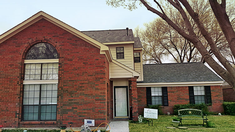 Two-story residential paint job in Rowlett, Texas