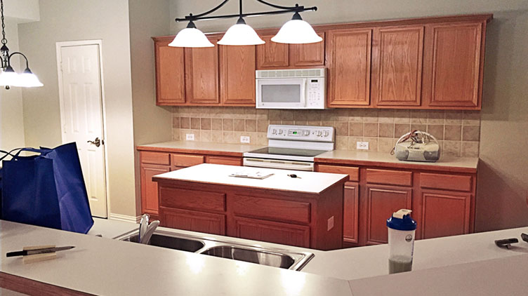 Kitchen cabinet refinishing before -- McKinney, Texas