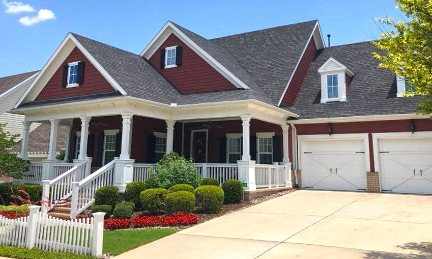 Red and White Craftsman style house with fresh paint
