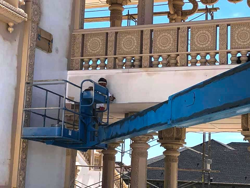Commercial Painting job with bucket lift in house of worship