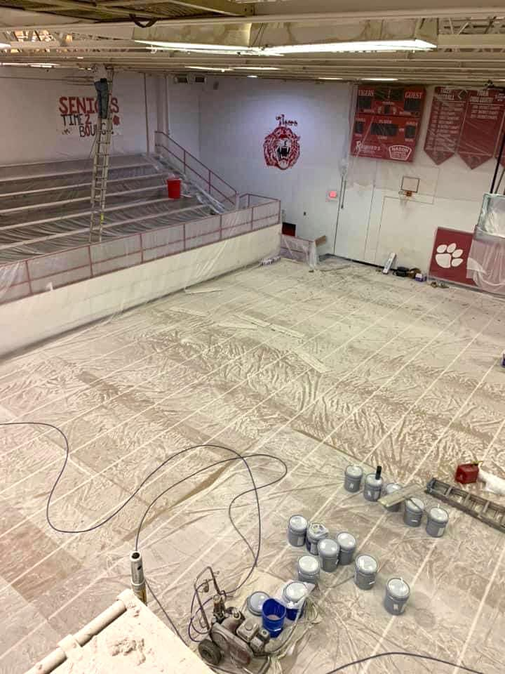 School gym floor protected from paint